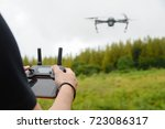 man operating a drone with... | Shutterstock . vector #723086317