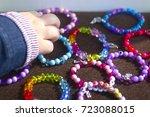the child takes baby bracelets... | Shutterstock . vector #723088015