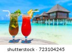 cocktail with blur beach on... | Shutterstock . vector #723104245