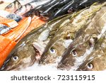 fresh cod and salmon on ice for ... | Shutterstock . vector #723115915