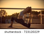 young woman practicing yoga... | Shutterstock . vector #723120229