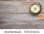 old fashioned brass compass on... | Shutterstock . vector #723131611