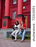 Постер, плакат: Two students read the