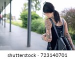 young brunette tattooed woman...   Shutterstock . vector #723140701