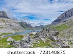 rock stack with mountain  lake... | Shutterstock . vector #723140875