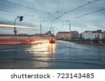 gloomy day in the city. tram on ... | Shutterstock . vector #723143485