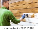 worker painting house exterior...   Shutterstock . vector #723179485