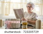 senior woman relaxing with... | Shutterstock . vector #723205729