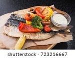 grilled vegetables and fish... | Shutterstock . vector #723216667