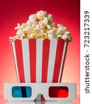 a large square box of popcorn... | Shutterstock . vector #723217339