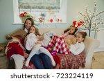 three little girls are relaxing ... | Shutterstock . vector #723224119