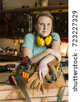 Small photo of Handy woman in her work shop
