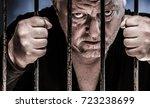 a man looks evil through the... | Shutterstock . vector #723238699