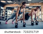 young couple is working out at... | Shutterstock . vector #723251719