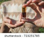 a small glass bottle of... | Shutterstock . vector #723251785