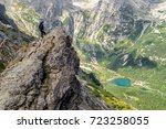 hiker woman on the rock at high ...   Shutterstock . vector #723258055