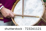 Detail Of A Drummer Dressed In...