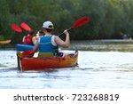 girl in red kayak kayaking in... | Shutterstock . vector #723268819