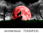 wolf howling at the red moon | Shutterstock . vector #723269131