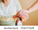 senior woman with her caregiver ... | Shutterstock . vector #723277639
