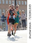 Small photo of STOCKHOLM - AUG 26, 2017: Running triathlete Bob Haller (LUX) followed by competitors in the Men's ITU World Triathlon series event August 26, 2017 in Stockholm, Sweden