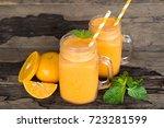 orange smoothies fruit on old...   Shutterstock . vector #723281599