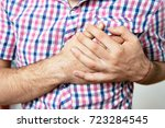 a man with a heart attack | Shutterstock . vector #723284545