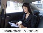 asian woman working in car ... | Shutterstock . vector #723284821