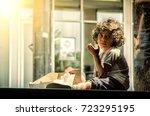 hungry homeless beggar orphan... | Shutterstock . vector #723295195