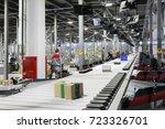 people work in modern workshop... | Shutterstock . vector #723326701