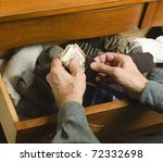 Man Hiding Cash In Sock Drawer