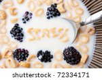 A bowl of alphabet cereal pieces floating in milk with the word STRESS spelled out. - stock photo