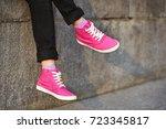 female feet in pink sneakers on ... | Shutterstock . vector #723345817