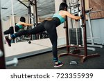 cute fit girl doing exercises... | Shutterstock . vector #723355939