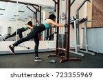 cute fit girl doing exercises... | Shutterstock . vector #723355969
