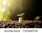 coins stacked on fertile soils. ... | Shutterstock . vector #723360754