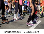 young woman in kangoo jumps... | Shutterstock . vector #723383575