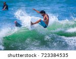 riding the waves. costa rica ... | Shutterstock . vector #723384535