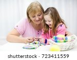 mother and child knitting. mom... | Shutterstock . vector #723411559