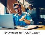 stressed male entrepreneur... | Shutterstock . vector #723423094