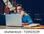 depressed male entrepreneur... | Shutterstock . vector #723423139
