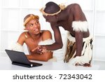 Two African Tribesman Learning...