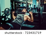 very strong bearded man doing... | Shutterstock . vector #723431719