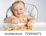 little baby eating her dinner... | Shutterstock . vector #723436471
