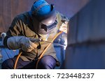 male  worker wearing protective ... | Shutterstock . vector #723448237