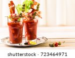 bloody mary cocktail garnished... | Shutterstock . vector #723464971