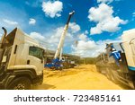 many truck and crane in yard... | Shutterstock . vector #723485161