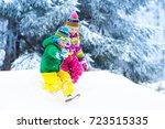 kids playing in snow. children... | Shutterstock . vector #723515335