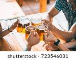 happy friends drinking beer and ... | Shutterstock . vector #723546031