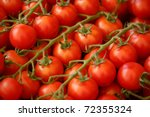 Red tomatoes closeup at a market place - stock photo